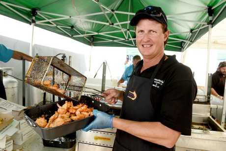 Hervey Bay Seafood Festival - Local fisherman Brett Fuchs kept the fryer busy cooking up the popular plate of coconut prawns.
