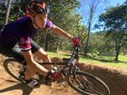 Mackay Christian College's Nathaniel Greentree is all concentration as he rails a berm during the Central Queensland Schools Mountain Bike Competition at Rowallan Park.