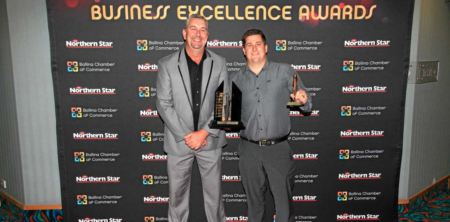 BUSINESS OF THE YEAR: Ballina Shire Advocate sales manager Alf Boston (left) after presenting Gavin Calnan from Solprom Advertising and Marketing the Business of the Year award at last Saturday's Ballina Coast and Hinterland Business Awards.