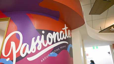 Heritage Bank has inspirational graffiti-style walls in the workplace.