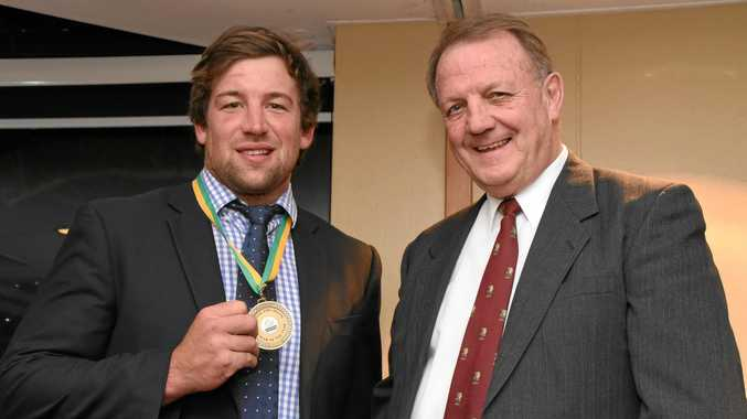 TOP EFFORT: Condamine captain-coach Roger Geldard shows off his Mal Eiby Medal for Risdon Cup player of the year with Mal Eiby.