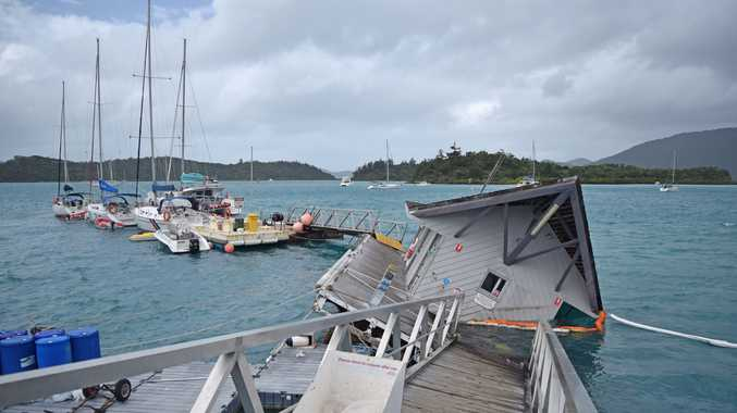 RISING TIDE: The Trinity Marine wharf, operating as Whitsunday Rent A Yacht, in Shute Harbour sunk on Monday night. 