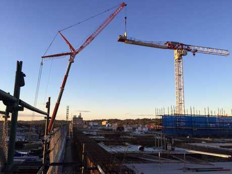 A crane is dismantled on the Grand Central redevelopment worksite.