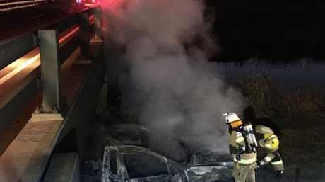 Police are investigating after an abandoned vehicle was found burning under a bridge near the Wellcamp Airport this morning.