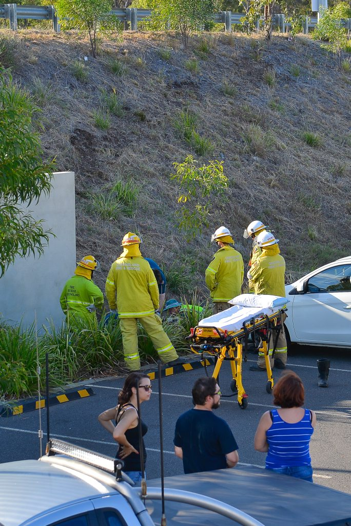 Motorcycle accident: A motorcyclist was thrown down the large embankment near the shops at Kin Kora. Photo Mike Richards / The Observer