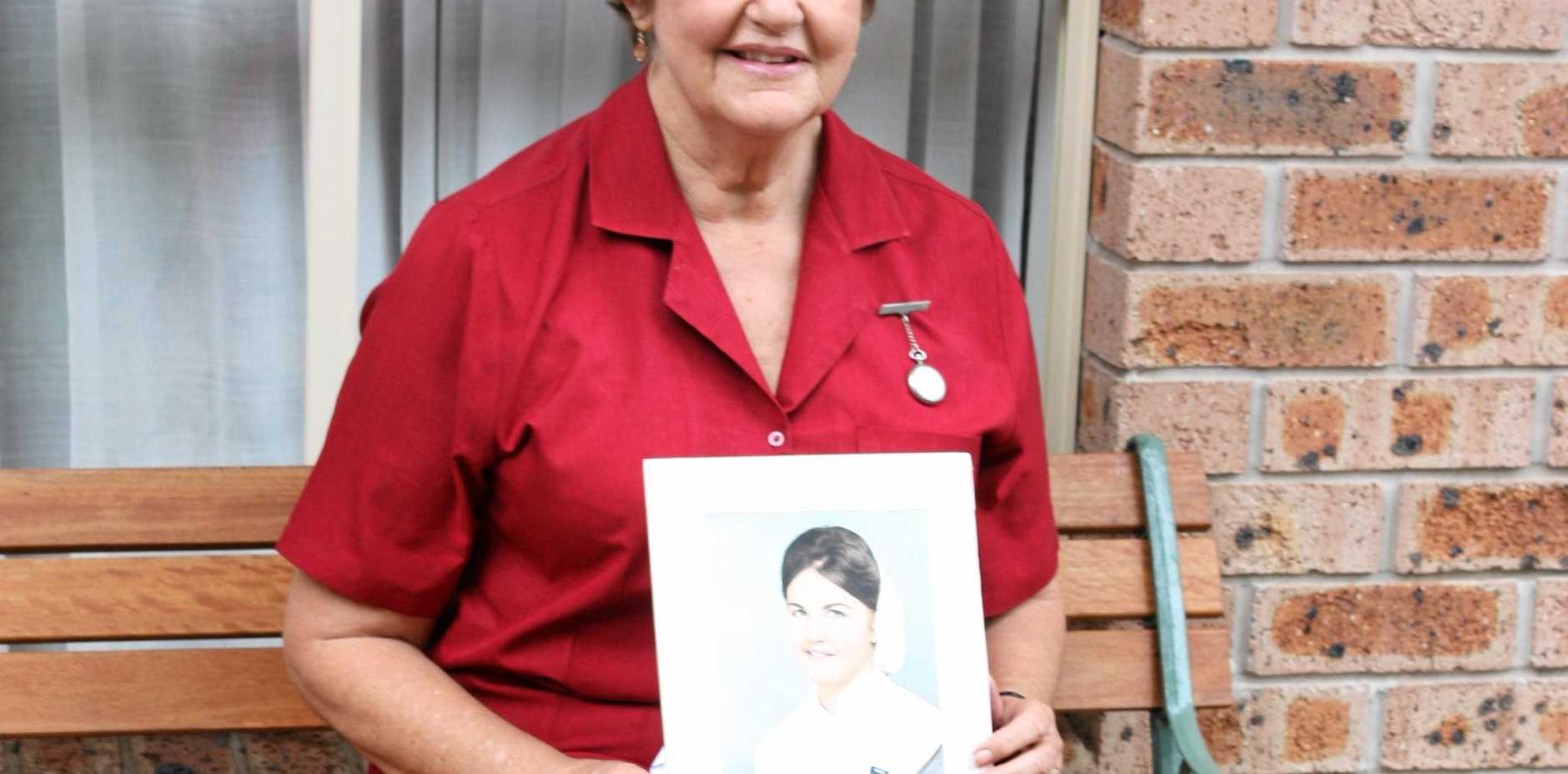 THEN AND NOW: Registered nurse Kay Hartley with a picture of herself  while in training.