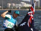 Tom Burton of Australia celebrates winning the gold medal in the Men's Laser class.