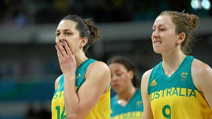 Marianna Tolo of Australia (left) and Natalie Burton leave the court dejected following the defeat in the quarter-finals to Serbia.