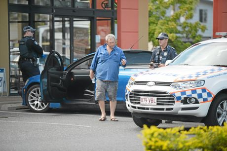 Police speak with a man at Glenmore.Photo Allan Reinikka / The Morning Bulletin