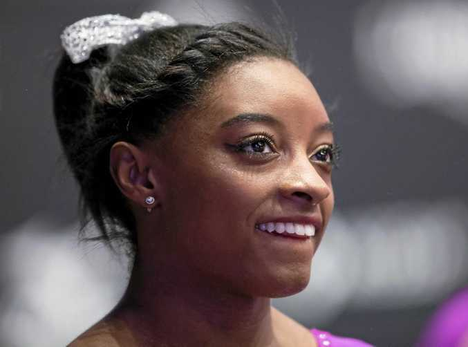 epa04993681 Simone Biles of the USA waits to perform on the Floor at the 46th FIG Artistic Gymnastics World Championships in Glasgow, Britain, 24 October 2015.  EPA/ROBERT PERRY