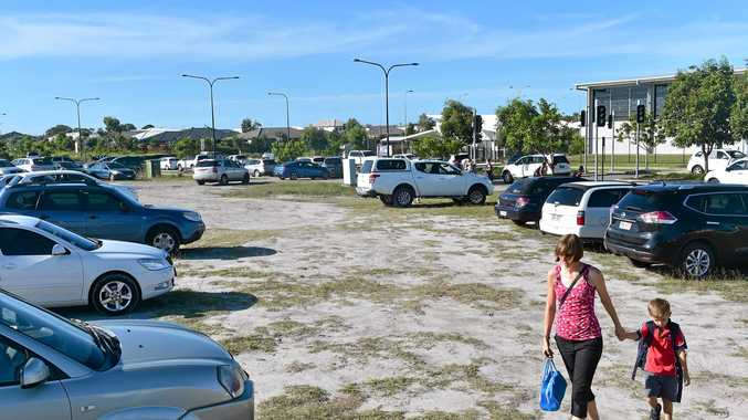 BAND AID: Vacant land outside Brightwater State School that is currently used as makeshift parking during the busy school pickup hours will soon be developed.