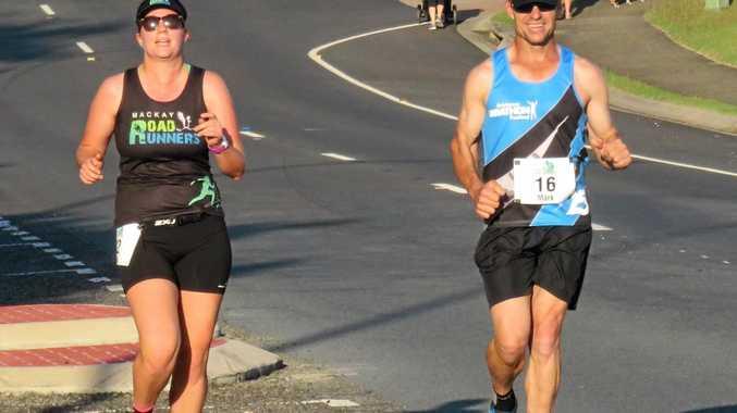 Emma Goodman-Jones and Mark McFadzen run down the descent in the 14km race.