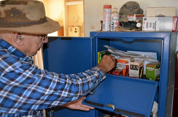 LOCK IT UP: Western Downs grazier Graham Hibbett checks the ammo shelf of his gun safe.