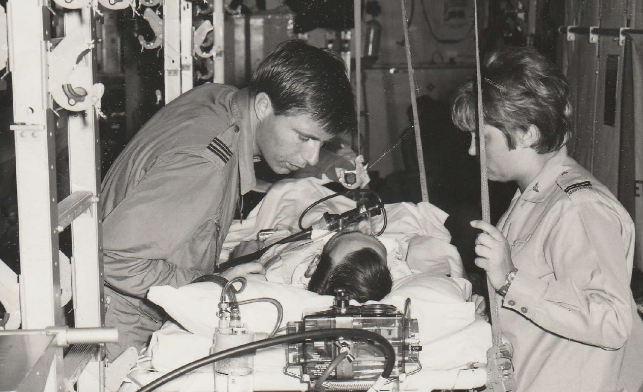 Nurse Ros Richards and a doctor during an aeromedical evacuation of a soldier on life support  in a Hercules aircraft from Vung Tau in 1970