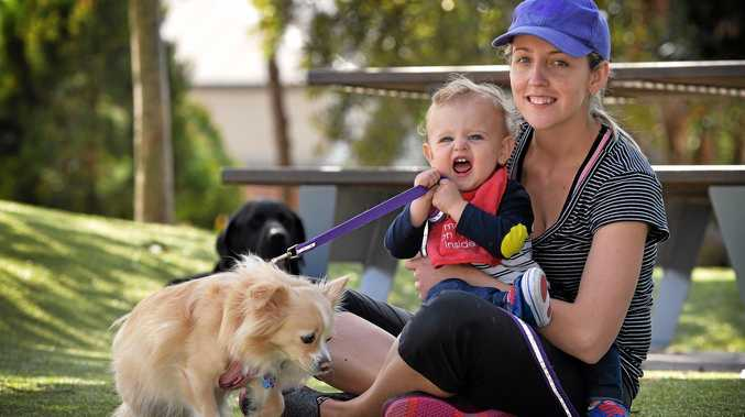 QUIET CHANGE: Allie Keogh with Riley, 1, and Hunnie the dog are happy to be moving from Bellvista to acreage where they hopefully won't hear the neighbours sneezing.