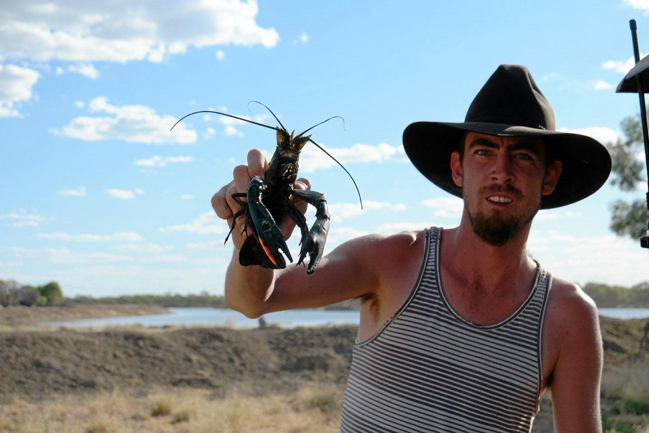 Deon Stent-Smith holding a wild-caught red claw.