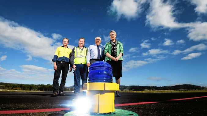 WELL LIT: Saunders Electrics owner Shane Saunders with Lismore City Council commercial services co-ordinator Kevin Trustum, Lismore MP Thomas George and Lismore mayor Jenny Dowell with the new light system installed at the Lismore Regional Airport.