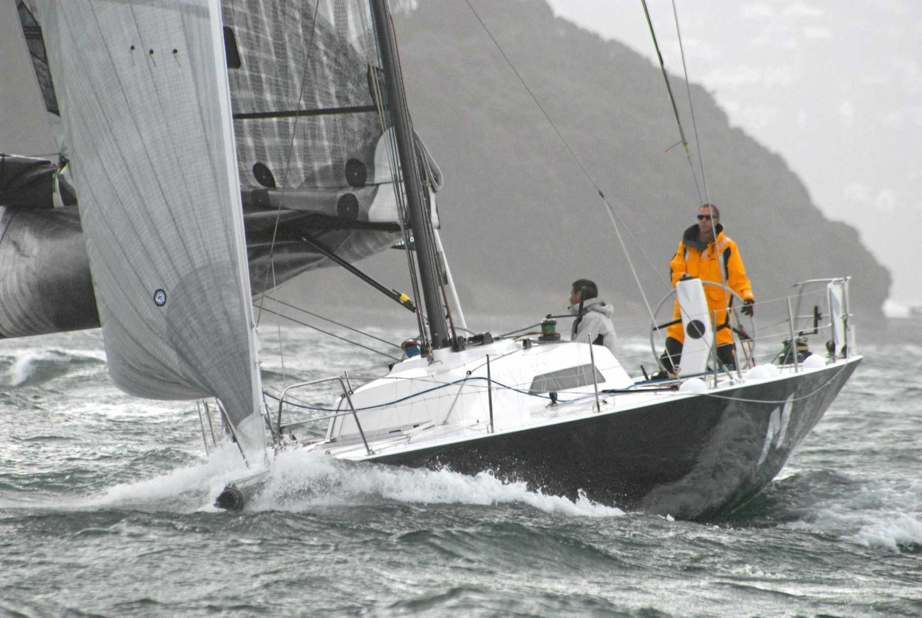 Dr Austin manning his yacht competing in the two-man race around the New Zealand north island.