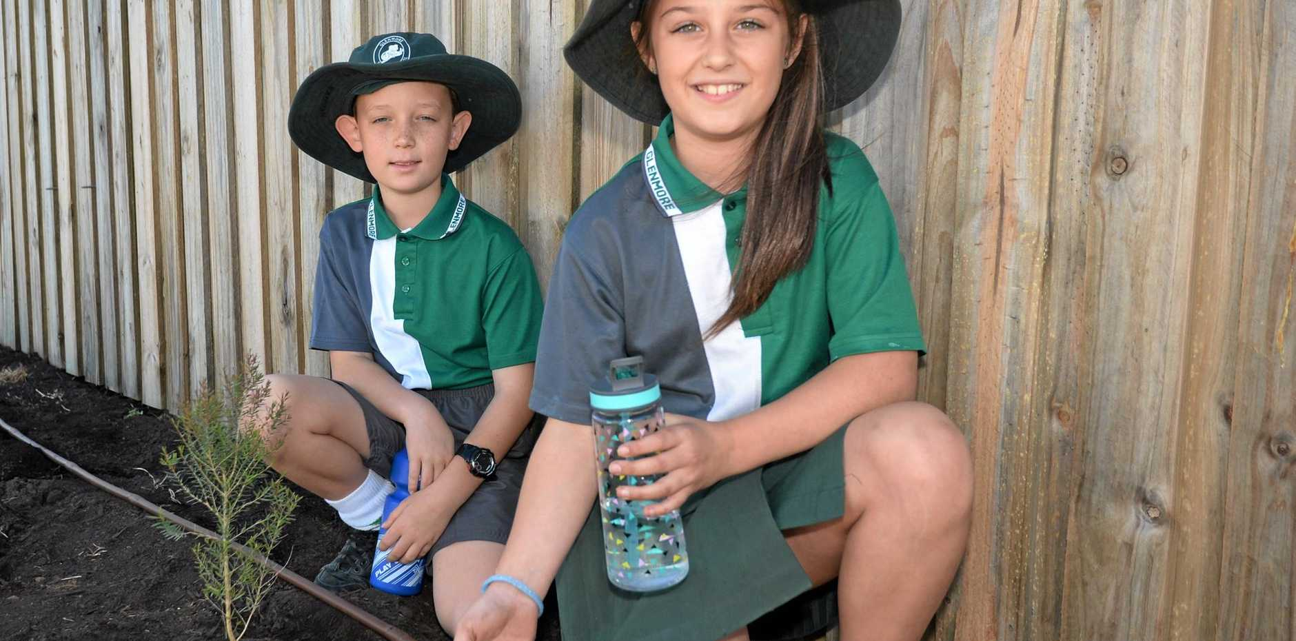 Glenmore State School students Maddison Pianta and Xander Brookman plant saplings as part of this years annual Schools Tree Day.