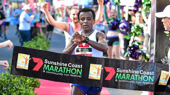 Sunshine Coast Marathon men's winner Samuel Woldemanuel, sets a new race record.