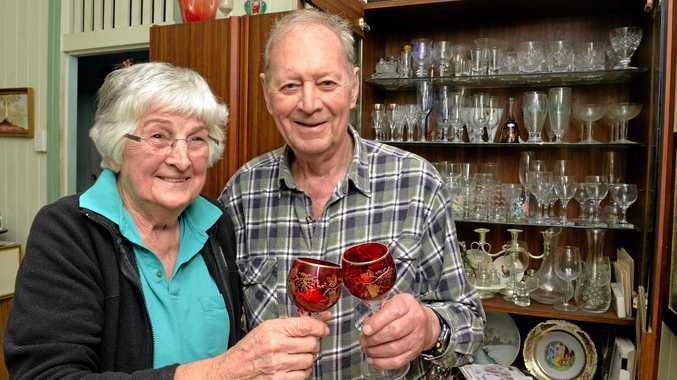 Bonnie and Brian Hull with their china cabinet after the eartquake in Mackay