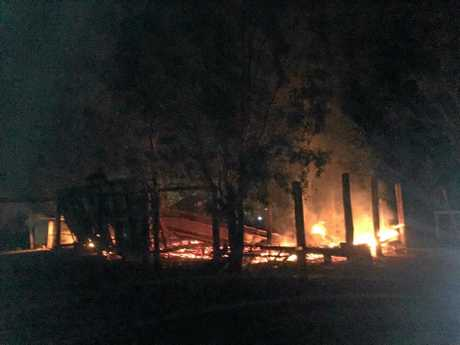ARSON: A photo taken on a phone of the Loaders' farmhouse as it burned that night.
