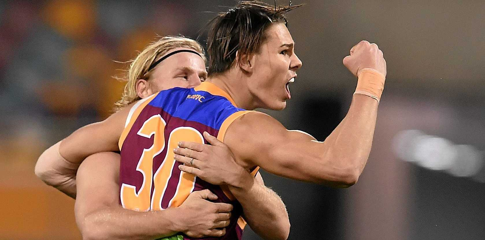RISING STAR: Eric Hipwood of the Brisbane Lions celebrates a scoring goal against Port Adelaide.