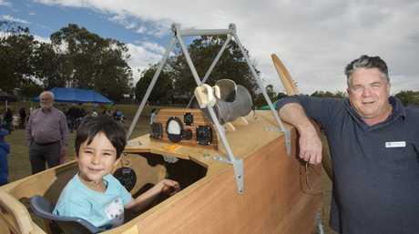Matai Ozaki, 7, has helped shape the Fantome bi-plane over the school holidays with the help of Ian Miller.