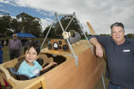 Matai Ozaki, 7, has helped shape the Fantome bi-plane over the school holidays with the help of Ian Miller.
