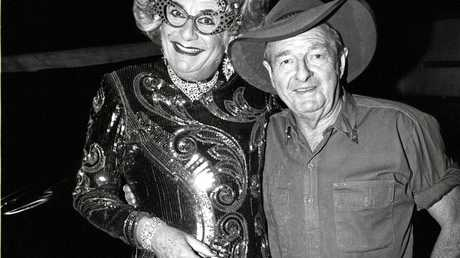 The iconic photo of Dame Edna with Slim Dusty is on show among the works by John  Elliott at the Crows Nest Regional Gallery.
