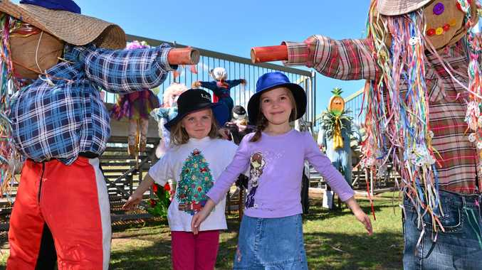 FUN AND COLOUR: Bonnie and Josie Taylor-Scott, 5 & 7 at Beerwah for the 45th Beerwah Charity Sports and Spring carnival. Photo: John McCutcheon / Sunshine Coast Daily