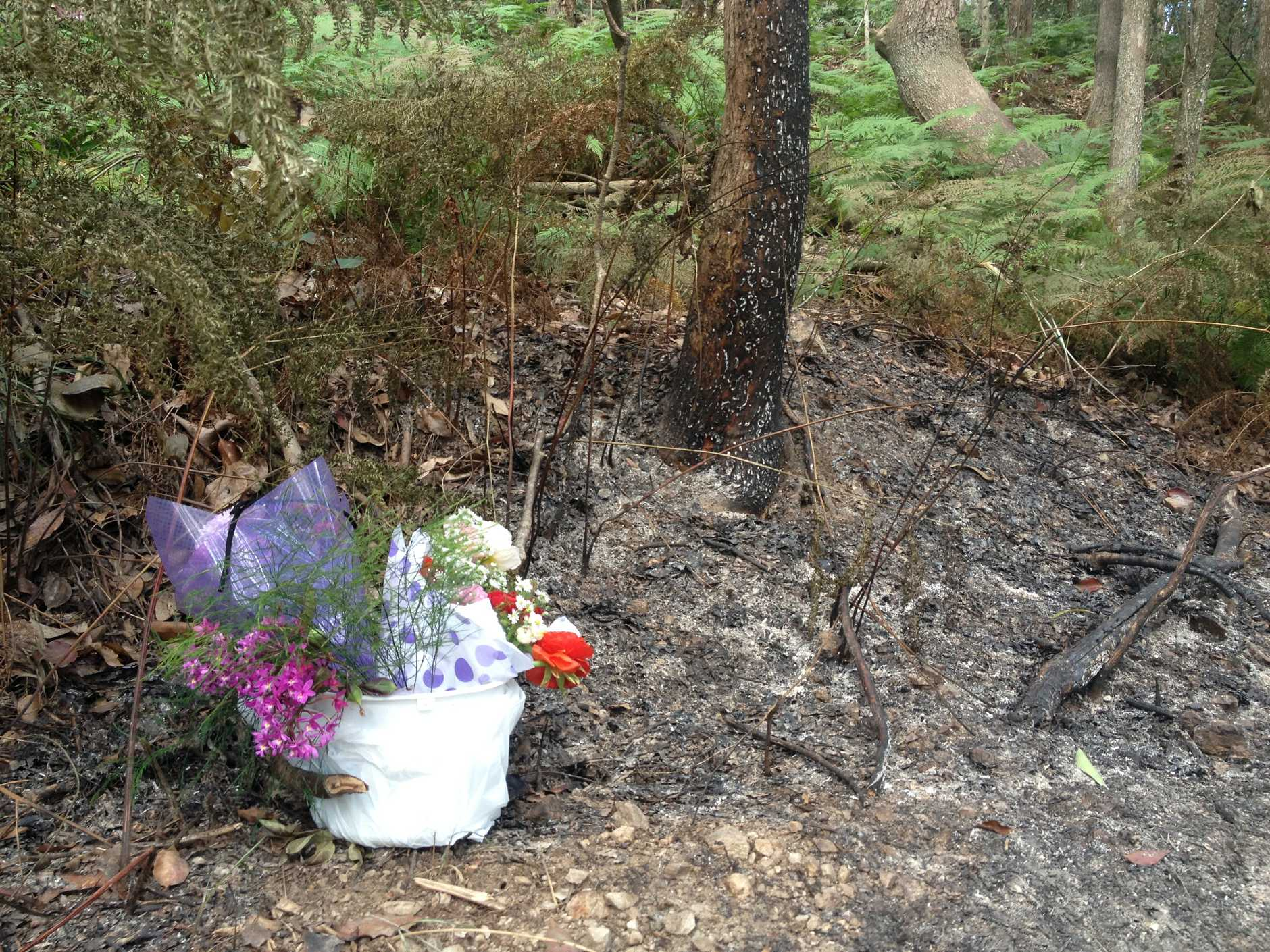 Flowers have been left at the tragic site of Sabrina Bremer's suspected homicide.