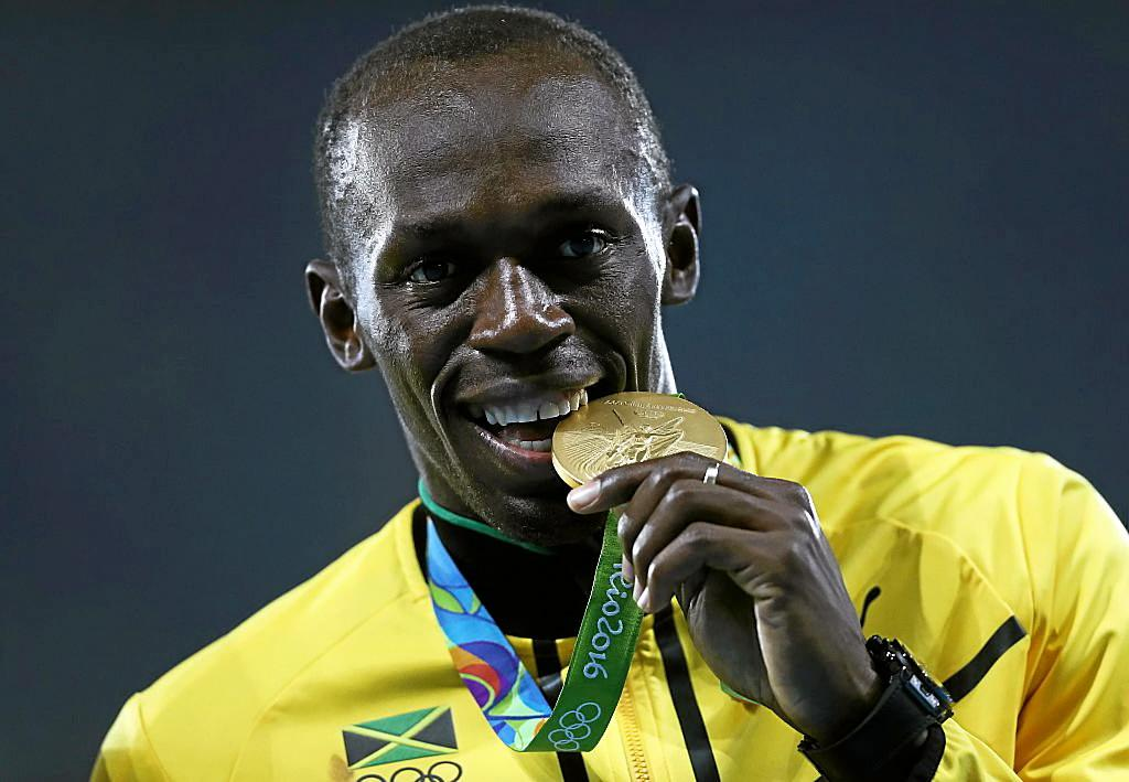 RIO DE JANEIRO, BRAZIL - AUGUST 20:  Gold medalist Usain Bolt of Jamaica stands on the podium during the medal ceremony for the Men's 4 x 100 meter Relay on Day 15 of the Rio 2016 Olympic Games at the Olympic Stadium on August 20, 2016 in Rio de Janeiro, Brazil.  (Photo by Patrick Smith/Getty Images)