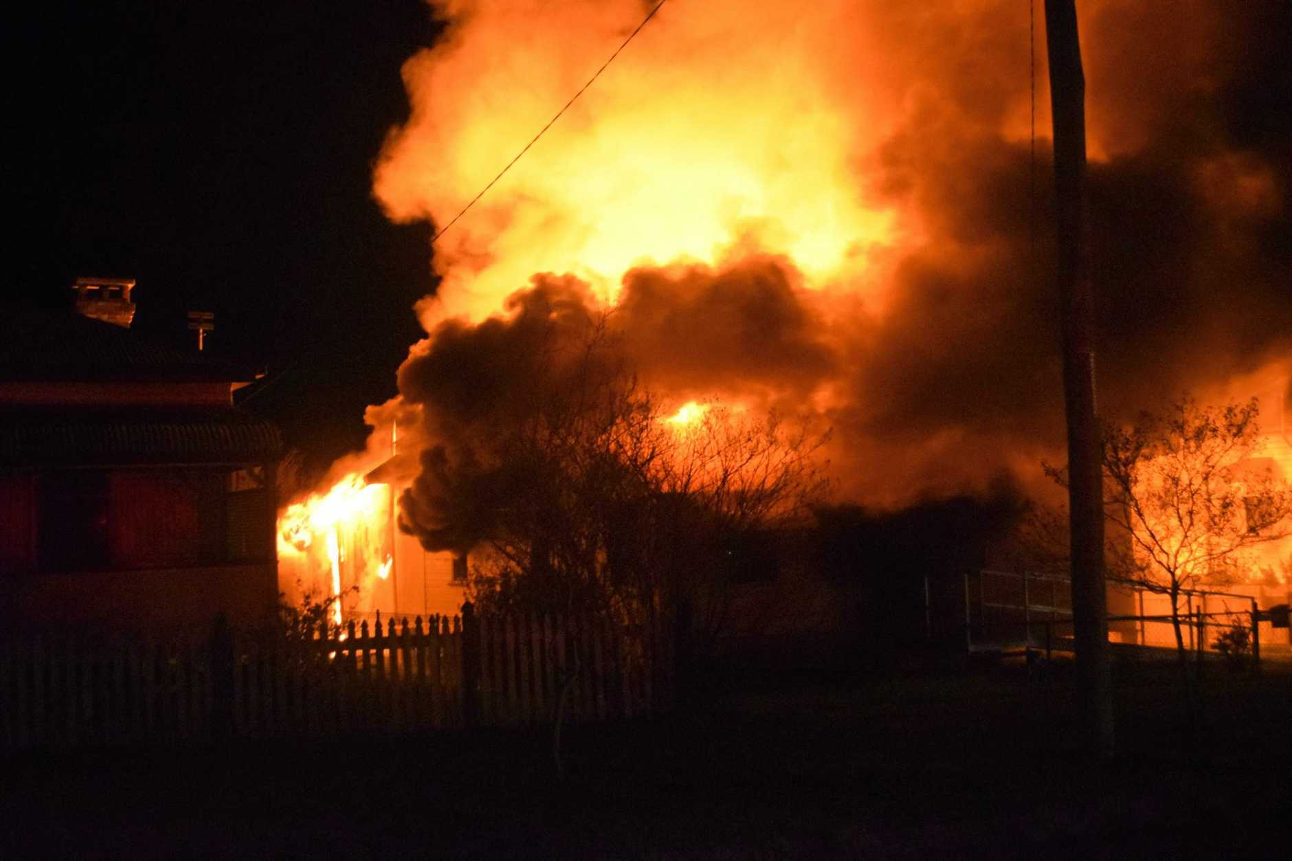 HOUSE ENGULFED: A man has died in a devastating Warwick house fire on Saturday night.