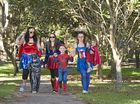 A family of superheroes (from left) Kay Holt, James Martin, Paige Holt, Calin Martin and Samantha Martin holding Elizabeth Martin joins the walk.