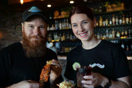 Ben Baker and Hazel Burns owners of Dirty Moe's bar, Mooloolaba.