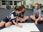 Rockhampton State High School students Emily Oram, Shanae Titmus and Michelle Langford work on their road safety ad.Photo Allan Reinikka / The Morning Bulletin