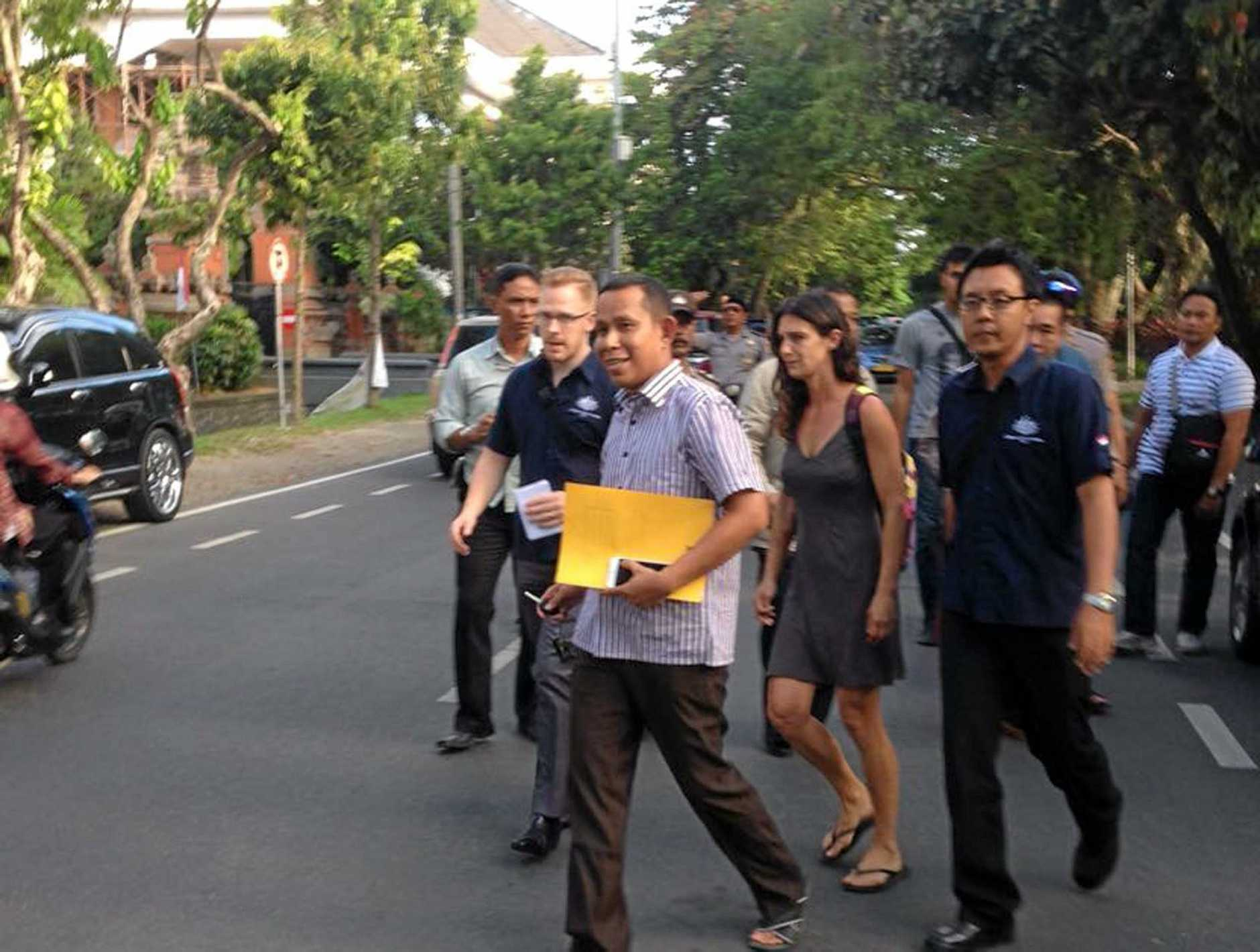 Police in Bali have arrested an Australian women and another man wanted for questioning over the death of an Indonesian policeman. Australian woman Sara Connor (C) and a British man David James Taylor, 33, were taken into custody in Denpasar at 2pm on Friday, August 19, 2016. (AAP Image/Putra Sinulingga)