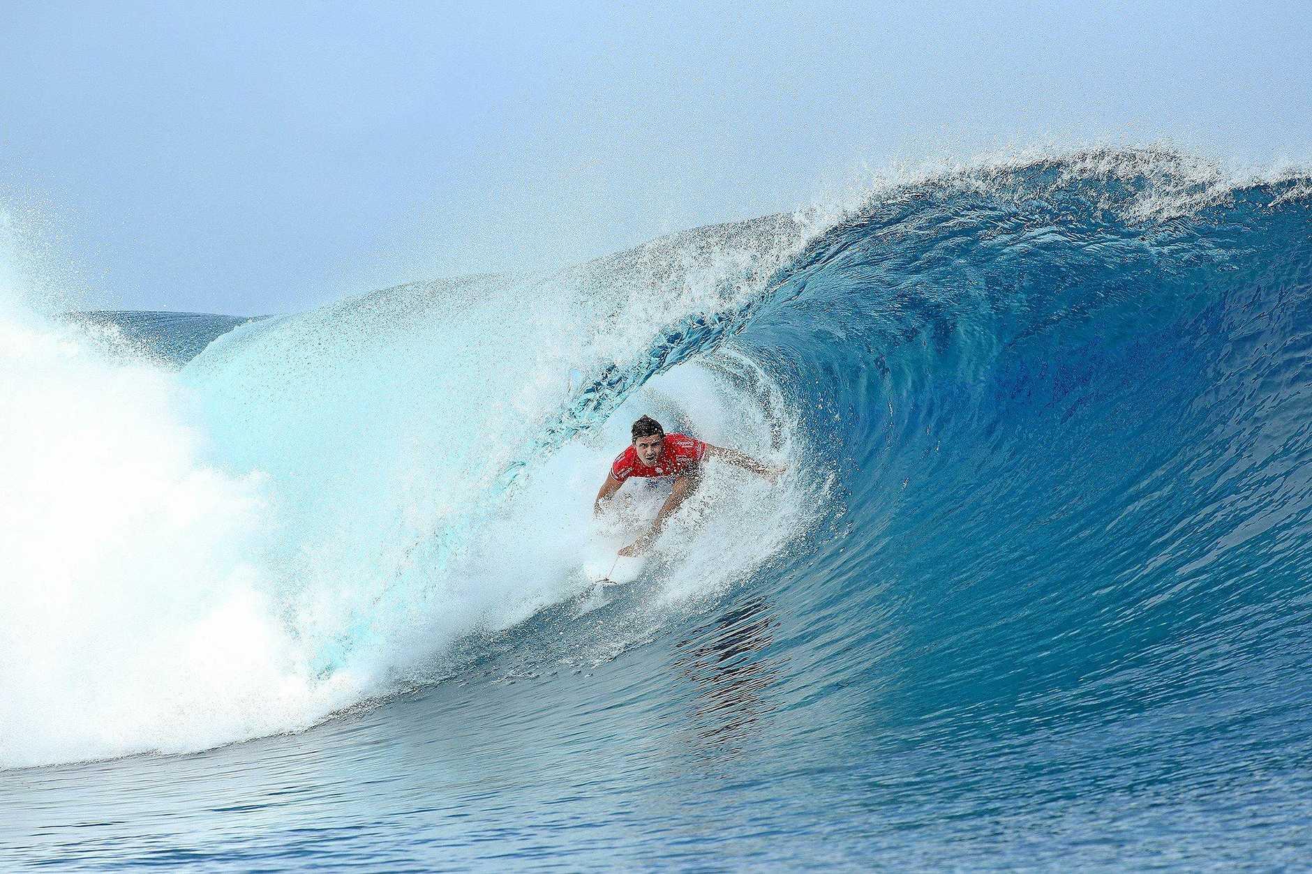 AT TAHITI: Julian Wilson ducks into a barrel at Teahupoo.