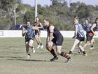 SHOT: The Bomberss Isaac Collihole shapes to kick as Bay Power's Ben Driscoll (left) closes in during Saturday's game.