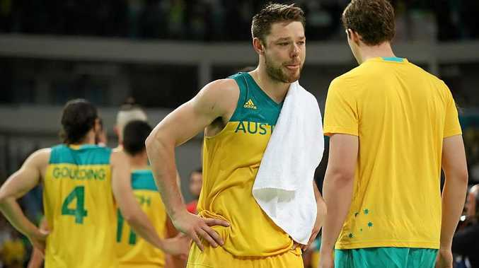 Matthew Dellavedova shows his emotion after losing to Spain.