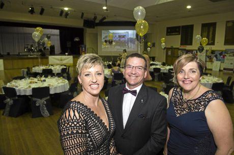 SERVICE HONOURED: Dressed up for the gala ball are Kate Price (left), Legacy treasurer Glenn Preston and organiser Tanya Linnett.