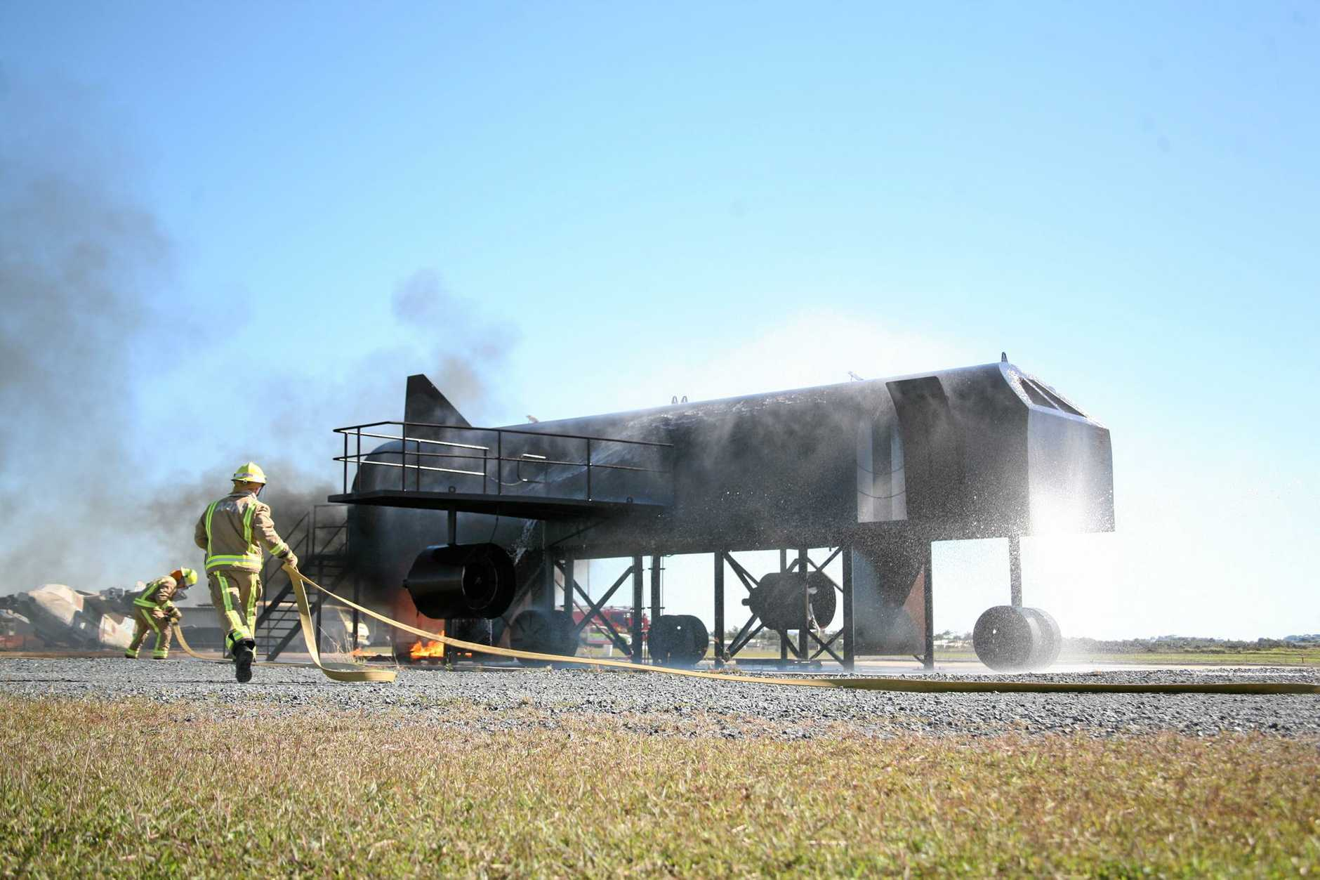 TRAINING: Fire crews at Mackay Airport during a training exercise.