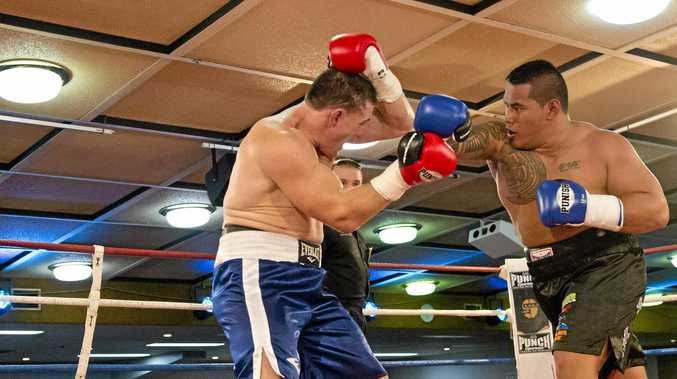 POWER PUNCH: Herman Ene-Purcell (right) takes on Paul Gallen at Rumours International in January.