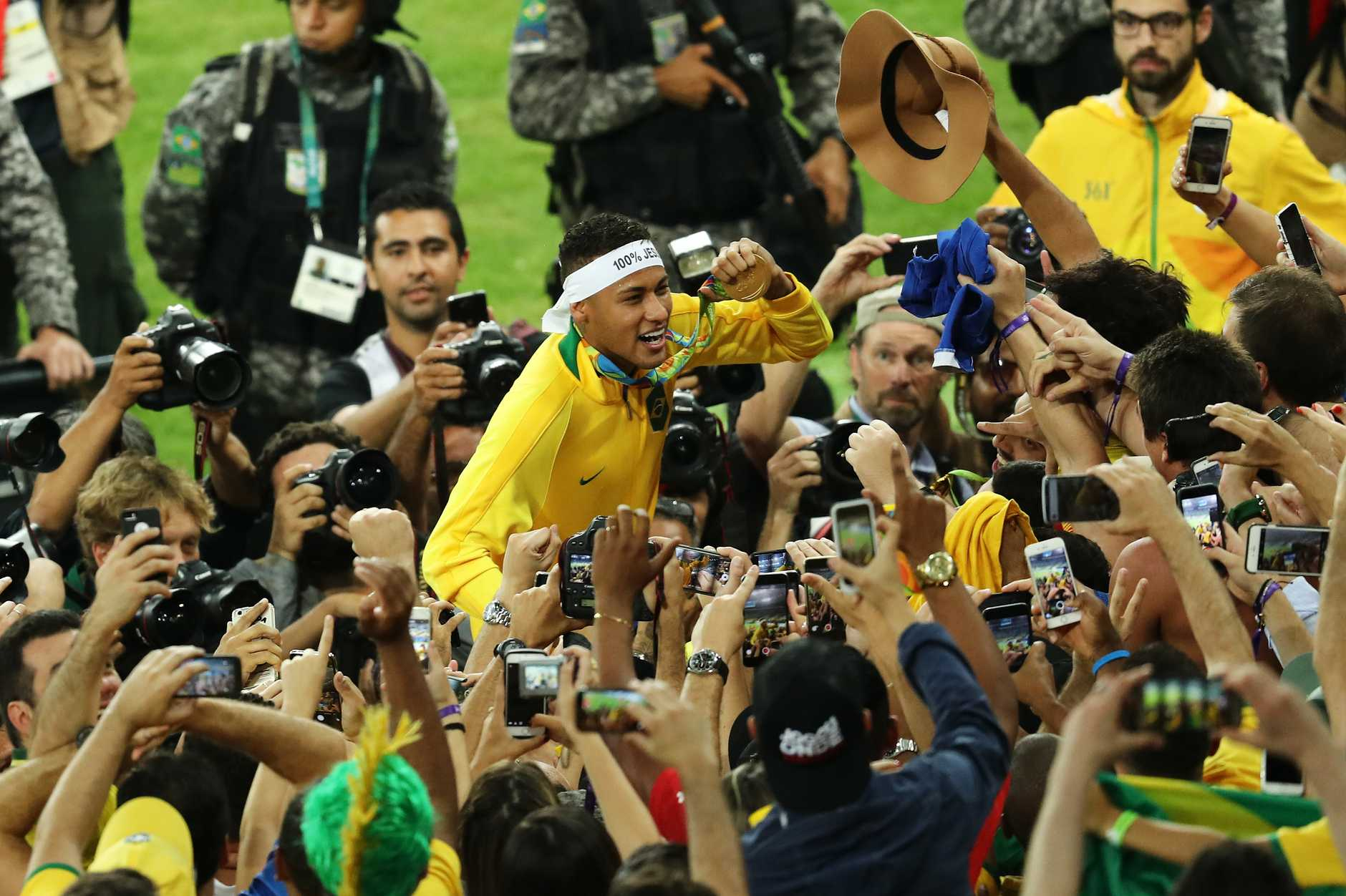 Neymar is swamped by media and fan after clinching the gold medal for his country.