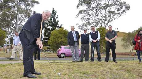 Mayor Paul Antonio tees off at Wilf Gowlett detention basin in South Toowoomba.