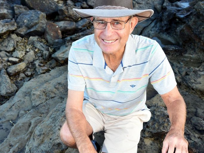 Richard Warden explains the uniqueness of the Point Vernon Coast Line - Six years of rock hopping has lead Warden to discover fossils that include suspected dinosaur footprints. Suspected femur and other bones could be fossilised in this rock.