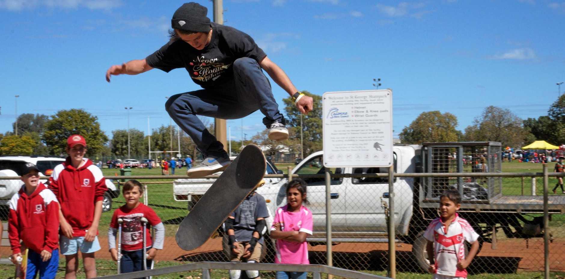 FLIP IT: The Skateboard Revolutions Workshop team showing their skills.