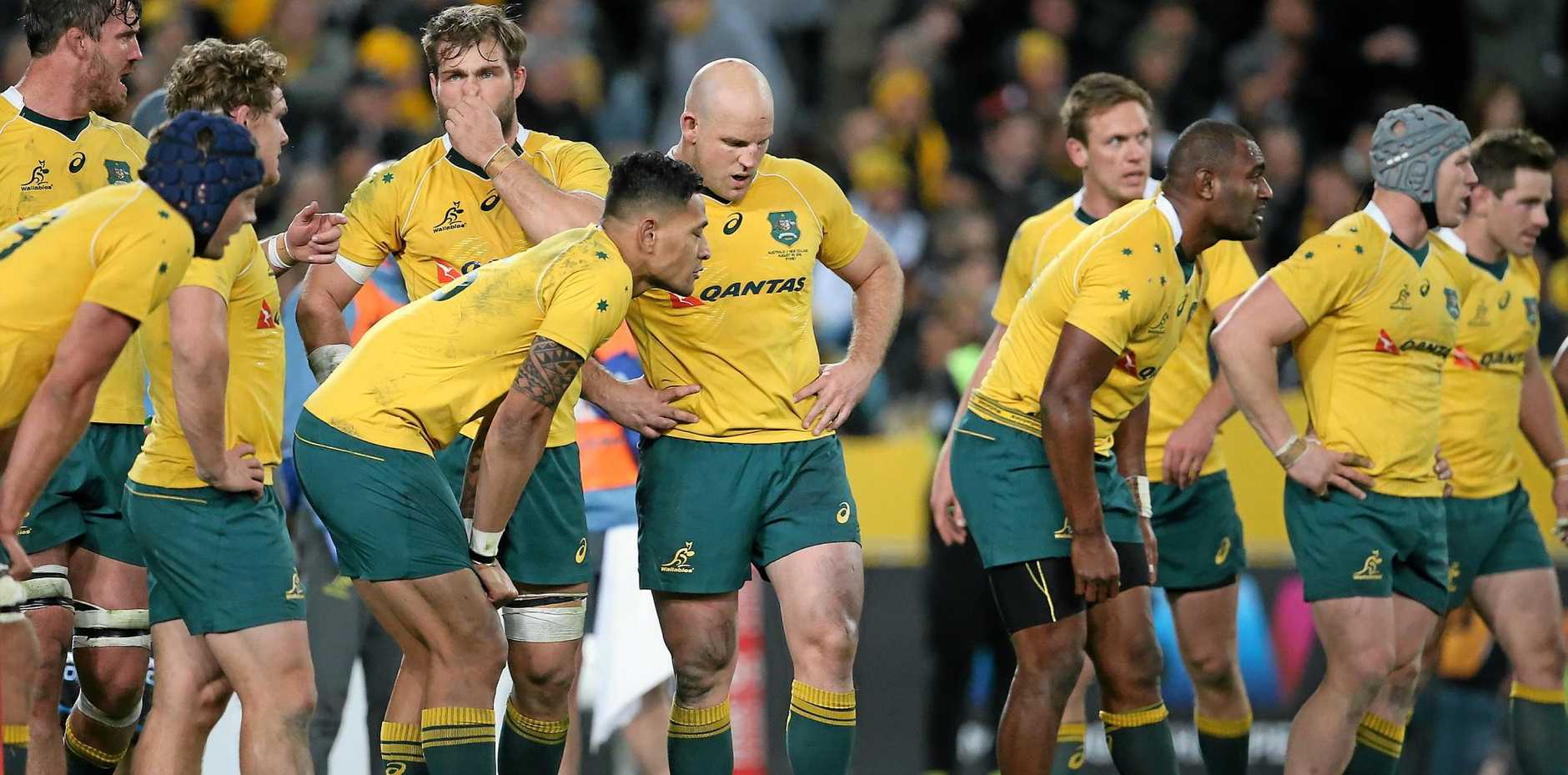 CRUSHED: Australian captain Stephen Moore stands with his teammates after their defeat in Sydney on Saturday.
