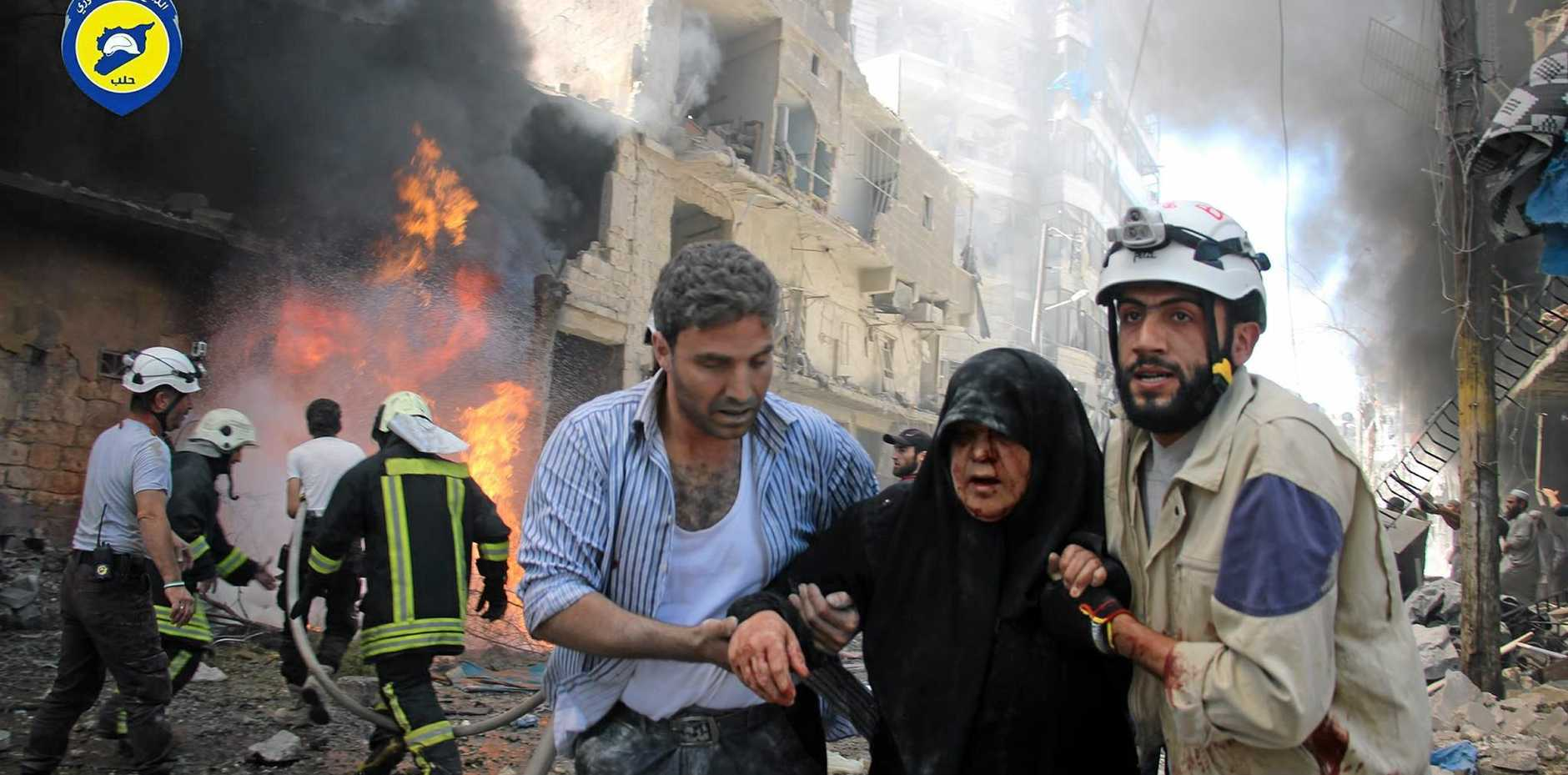 STOP THE BOMBING: An Injured woman is helped after warplanes attacked a street in Aleppo, Syria. One of the last doctors in the city says the bombing has destroyed medical services, putting thousands of lives at risk.